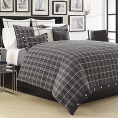 Plaid design at its finest. Ventana duvet by Nautica incorporates charcoal and ivory into its plaid design. The comforter reverse is solid. The coordinating shams and pillows add to the style of this ensemble. All pieces are 100% cotton exclusive of the trim. Take the style of your bedroom to new heights when adding a brand new Nautica bedding ensemble.