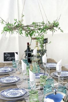 love the blue and white plants and hanging wreath