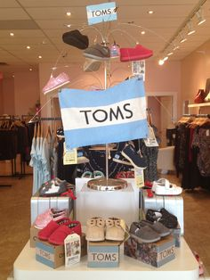 Tiny Toms display for Bellies by Flourish Design & Merchandising.  Visual Merchandising, shoes, baby