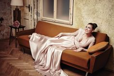 Singer Adél Csobot in a blush pink lace and satin Daalarna gown
