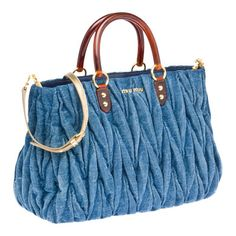 Matelassé washed denim tote Tortoiseshell Plexiglas handleBrass hardware and nappa leather detailsMiu Miu shopping in denim jeansDiscover the Miu Miu online boutique and shop the new collections of clothes, shoes, bags, accessories and jewelry. Denim Handbags, Tote Handbags, Purses And Handbags, All Jeans, Jeans Denim, Denim Purse, Stylish Handbags, Recycled Denim, Quilted Bag