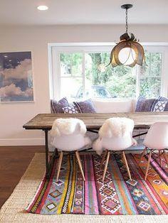 layered rugs--interesting idea.