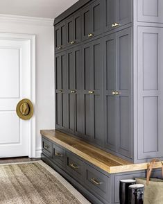 Modern farmhouse with a mud room with black shaker cabinets and an oak bench . Modern farmhouse with a mud room with black shaker cabinets and an oak bench with brass buttons and handles. , Modern Farmhouse featuring a mudroom wi. Modern Farmhouse, Country Modern Home, Farmhouse Kitchens, Farmhouse Cabinets, Farmhouse Bench, Country Farmhouse, Mudroom Cabinets, Mudroom Laundry Room, Mud Room Lockers