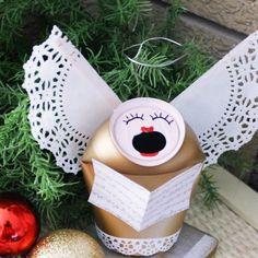 You know you're a redneck if your Christmas angels are made from beer cans and doilies....I do admire the creativity here, though.
