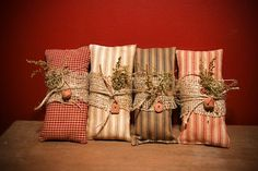 Prim Pillow ~ Shelf tuck These little pillows are stained, wrapped in burlap, and tied with twine with a little Sweet Annie tucked in.They measure long - From The Keeping Room Primitive Pillows, Primitive Patterns, Primitive Crafts, Primitive Christmas, Primitive Decorations, Christmas Sled, Primitive Stitchery, Primitive Snowmen, Christmas Things