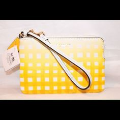 "NWT Coach Sunglow Wristlet NWT Coach Sunglow Yellow & White Wristlet.  Measures approx 6 1/2"" in length & 4 1/2"" in height Coach Bags"