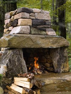 rustic outdoor fireplace made from natural stone