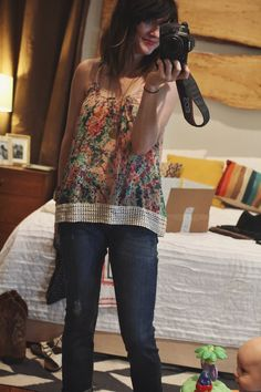 Those jeans are cute on her. Kut from Kloth Kate (I think). Not crazy about the top - I just don't really do spaghetti straps.