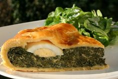 Pascualina is a traditional dish from Uruguay with spinach and hard-boiled eggs filled pastry typically eaten during Lent. ---I substituted the frozen spinach for fresh kind, more work, but worth it.---