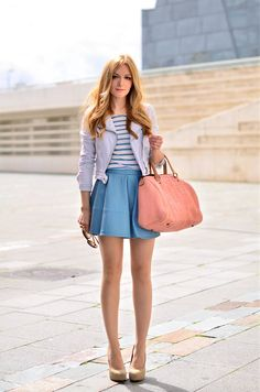 Love this! Leather jacket over striped top and cute skirt.