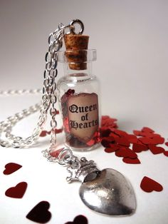 """Alice In Wonderland """"Queen of Hearts"""" corked bottle of red shiny hearts with dangling silver heart with crown charm on 24"""" silver chain"""