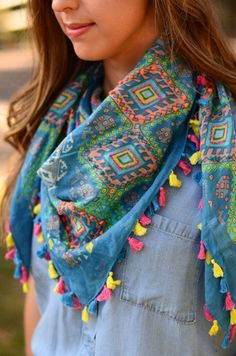 Look at the bright, vibrant colors woven into this beautiful scarf! It has fun tassels and a light material making it the perfect spring time scarf! It will look perfect with your spring outfits!