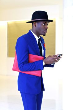 I love everything but the pink envelope bag. The blue is bold enough. Not every man can wear this but this guy looks fab!