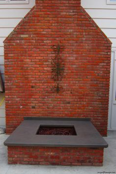 Fire-pit, solid gray/green color, square front edge. Done by James McGregor with McGregor Designs