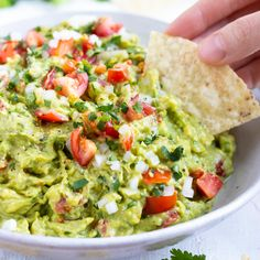Easy Homemade Guacamole Recipe - The BEST Guacamole recipe that is a quick, easy, and healthy avocado dip for a dinner party snack or - Salsa Guacamole, Best Guacamole Recipe, Low Sodium Guacamole Recipe, Magic Bullet Guacamole Recipe, Guacamole Recipe Food Network, Gluten Free Guacamole Recipe, Avacado Snacks, Homemade Guacamole Easy, Healthy Avocado Recipes