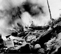 A US Marine dives for cover in his bunker as a communist 82 millimeter  mortar shell explodes on a ridge in eastern Korea, April 8, 1952