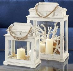 Create a beach theme display inside candle lanterns... http://www.completely-coastal.com/2014/03/beach-lanterns.html These large wooden lanterns leave plenty of space for a beach theme display around the candle.