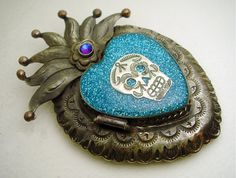 I saw one in red... tres cool. Antiqued Mexican Sacred Heart Locket Pendant by tesoromexicano, $39.95