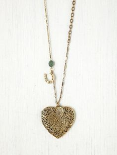 at Free People // gold heart locket necklace