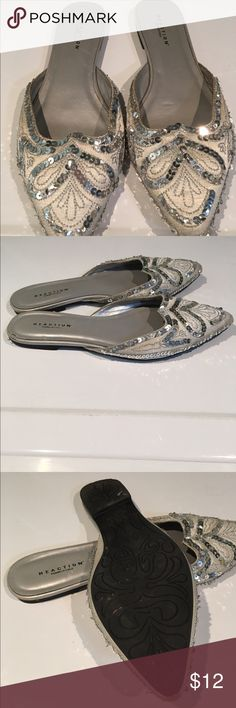Beautiful Kenneth Cole Reaction silver sandals 7.5 These are beautiful!!! Flats...sequins and shimmer...oh my. They are size 7.5.  We are cleaning out closets and have many designer items to sell. Please check out my closet.  Priced to sell!!! Kenneth Cole Reaction Shoes Flats & Loafers