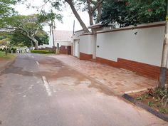 KZN Property Maintenance Service, installed a paved drive in upper Durban North.  Check out the before, during and after pictures to see the difference this professional job made to the entrance and overall appearance.  www.kznprop.co.za info@kznprop.co.za 031 564 3855 Entrance, Garage Doors, Deck, Outdoor Decor, Pictures, Home Decor, Photos, Entryway, Decoration Home