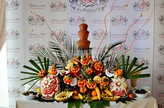 Chocolate fountain and an exotic fruit cascade