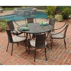 Home Styles 5601-368022 Stone Harbor 7-Piece Dining Set with Table and Laguna Arm Chairs, Black Finish, 51-Inch by Home Styles. $1197.04. Stone harbor 7-piece dining set includes large round dining table and six laguna arm chairs. Measures 51-1/4-inch width by 51-1/4-inch depth by 29-1/2-inch height; chair measures 23-1/4-inch width by 22-1/4-inch depth by 36-inch height. Constructed of small, square, hand applied slate tiles with no two tops being exactly the same in a nat...