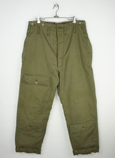 This is an authentic pair of 1940's Type A-9 extreme cold weather flight pants. Great piece of American Military history, these fantastic pants are well worn, and show some wear, but are in overall gr