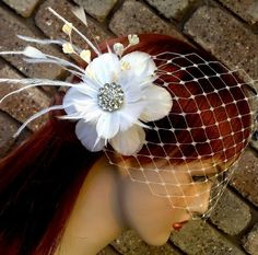 Spring Wedding Hair Accessories Flower Feather  by YJDesign, $125.00.... A slight difference to the birdcage veil..
