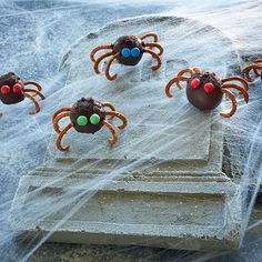 These easy chocolate peanut butter balls with pretzel legs make fun, creepy-crawly Halloween treats. Your kids will bug out over these cute bite-sized bugs!