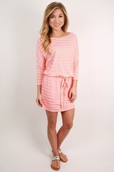 This fabulous striped dress is just perfect for spending a day at the beach! Pair it with your favorite sandals and a pretty hat. You can wear it over your bathing suit as a cover up, or just wear it as a dress! No matter how you wear it, you're sure to be cute and comfortable all day long! Features an adjustable waist.