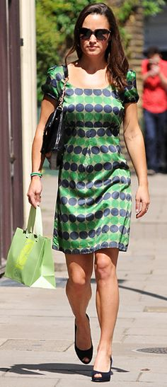 Middleton strolled through London's Chelsea neighborhood in a green and blue polka dot dress and navy peep toe pumps.