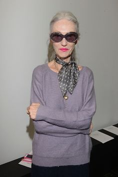 Linda Rodin.  I think one reason this works is that the lipstick goes with the pinky undertones of the grey/greyed lavender sweater.