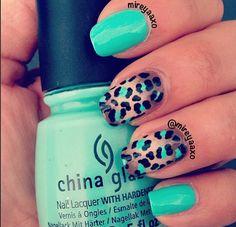 chetah print with a mint green nail polish design