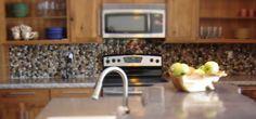s 13 incredible kitchen backsplash ideas that aren t tile, kitchen backsplash, kitchen design, Create a full pebble backsplash