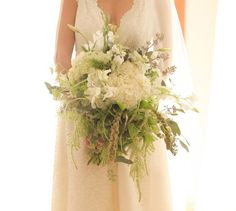 big whimsical green and white bouquet DIYed by the bride on Green Wedding Shoes.  Photo by Jana Williams Photography.
