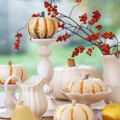 love the flea market white candlesticks and pitchers: tabletop decor with white pumpkins for fall via bhg.com