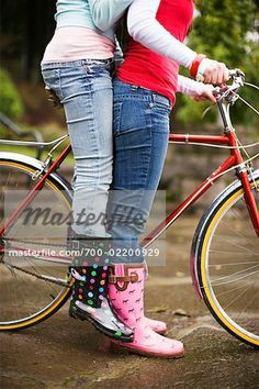 6a82a5000f0 Two Teenage Girls Riding Bicycle - Stock Photos : Masterfile