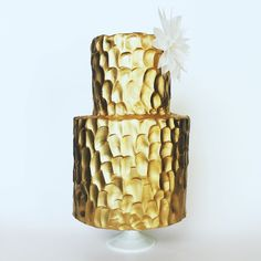 Hammered gold cake with delicate white wafer paper dahlia flower