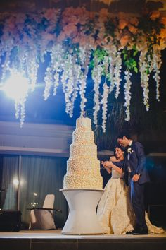 Priya + Shayan - An Elegant Indian & Iranian Wedding in Bali - destination wedding - wedding reception - wedding reception set up - decorated marquee - floral marquee - chandeliers in marquee - 5 tier cake - firve tiered cake - Villa Latitude - Uluwatu #thecrimsonbride