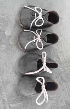 Cute little grey booties for babies.