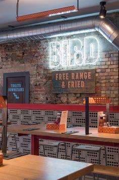 Brinkworth restored original facade to reveal glazed bricks and signage for new London restaurant.