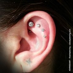 4 Piercing Ear Project with Rook piercing by Chris Saint