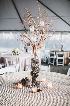 winter wedding centerpiece ideas / http://www.deerpearlflowers.com/twigs-and-branches-wedding-ideas/