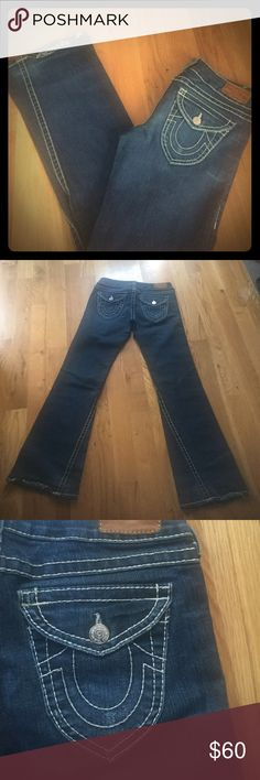 True Religion Joey Jeans sz 32 True Religion Joey Jeans sz 32 medium dark rinse. I've had these for a while. They were either purchased at the True Religion store off of Union Square in NYC or the True Religion Store in Shops at Columbus. Never altered. The distressed hem is a manufactured look. These are a nice quality jean. Looking to sell quickly. Make offers! True Religion Jeans Flare & Wide Leg
