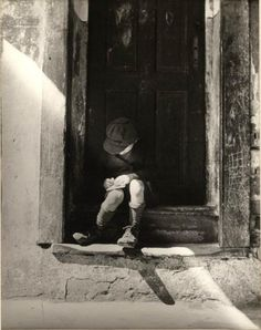 Roman Vishniac    Writing a letter to his mother, who is working in Lodz. Warsaw, 1937