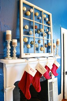 """Loving This Mantle! I really like the old window with hanging ornaments in each """"pane"""". Also digging the jute wrapped candles and silver candlesticks! #DIY #Mantle #Christmas"""