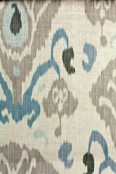 Annapurna Linen Fabric  A lovely printed ikat design in pale blue and grey on a cream background. Suitable for domestic upholstery and curtains.