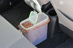 Line a plastic cereal container with a grocery bag and use it as an in-car trash can. Especially useful for long drives with the family!