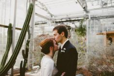 Winter Bride and Groom in the Arid Garden at Meijer Gardens, Grand Rapids Michigan wedding. [EverPhoto Photography]